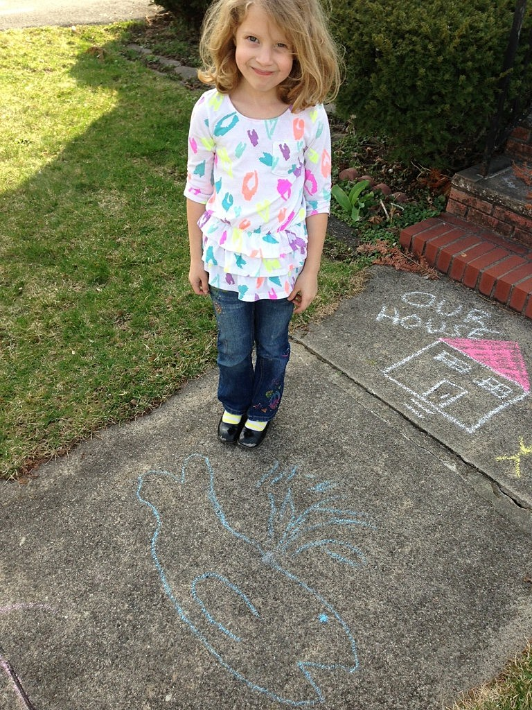 My 6 year old, Morgan with her chalk drawing of a whale