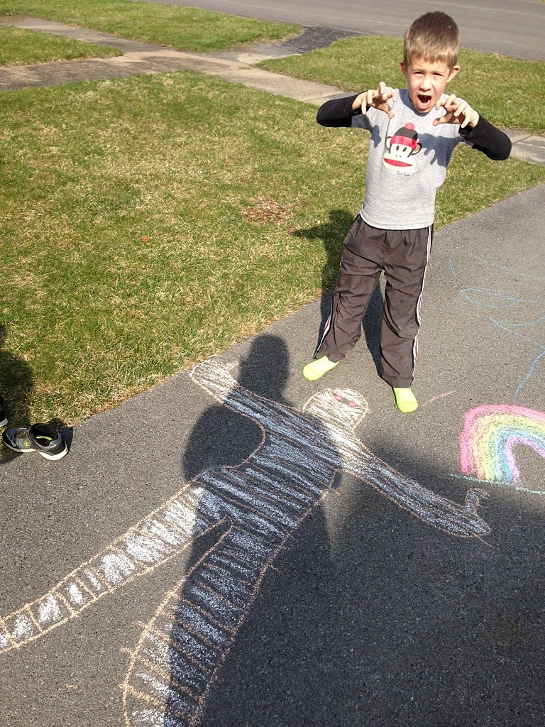My 8 year old son, Brady with his chalk drawing of a mummy
