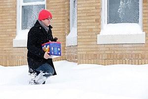 Man carrying beer in winter