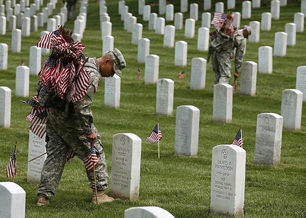 Placing Flags on graves at Arlington National Cemetery