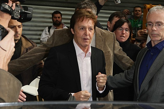 Paul McCartney outside a car
