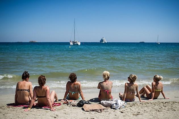 summer beach with women sitting