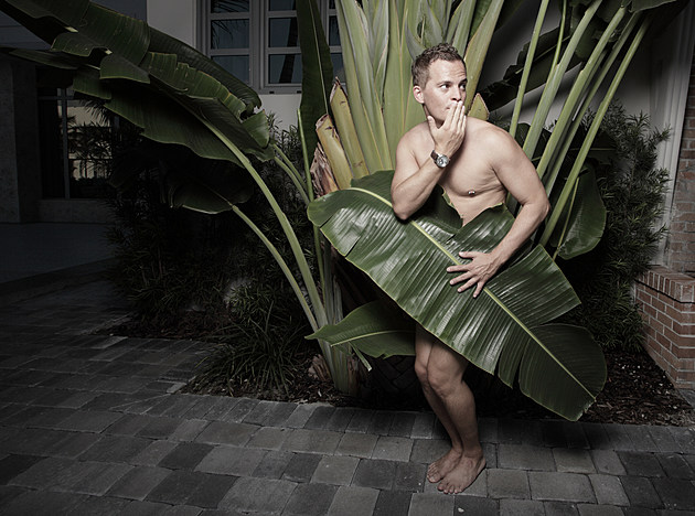 Man covered by a leaf